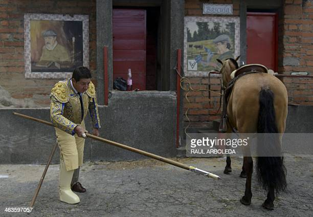 A Picador is prepares before his bullfight at La Macarena bullring on January 18 2014 in Medellin Antioquia department Colombia AFP PHOTO/Raul...