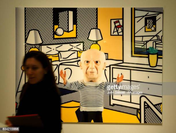 A Picasso artwork by Maurizio Cattelan in the Martian Museum of Terrestial Art Exhibition seems to beckon a female art lover at the Barbican Art...