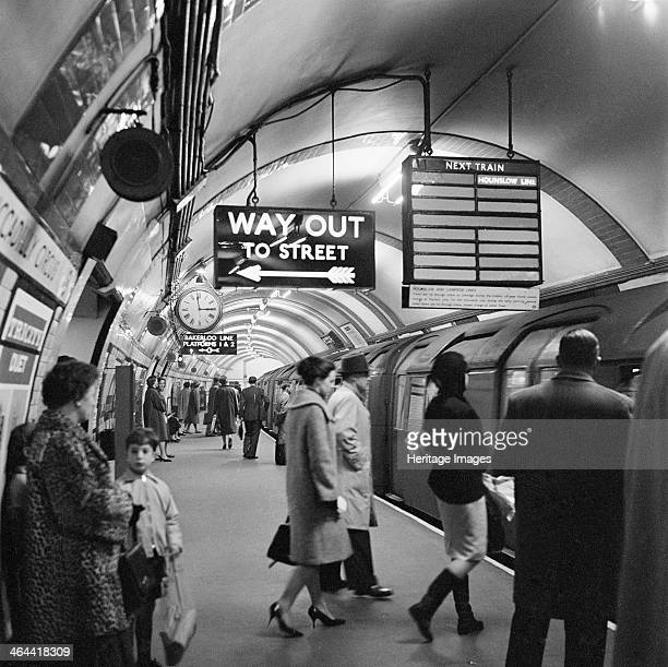Piccadilly Circus Station London 19601965 Platform at Piccadilly Circus underground station showing people entering a Hounslow Line train and the...