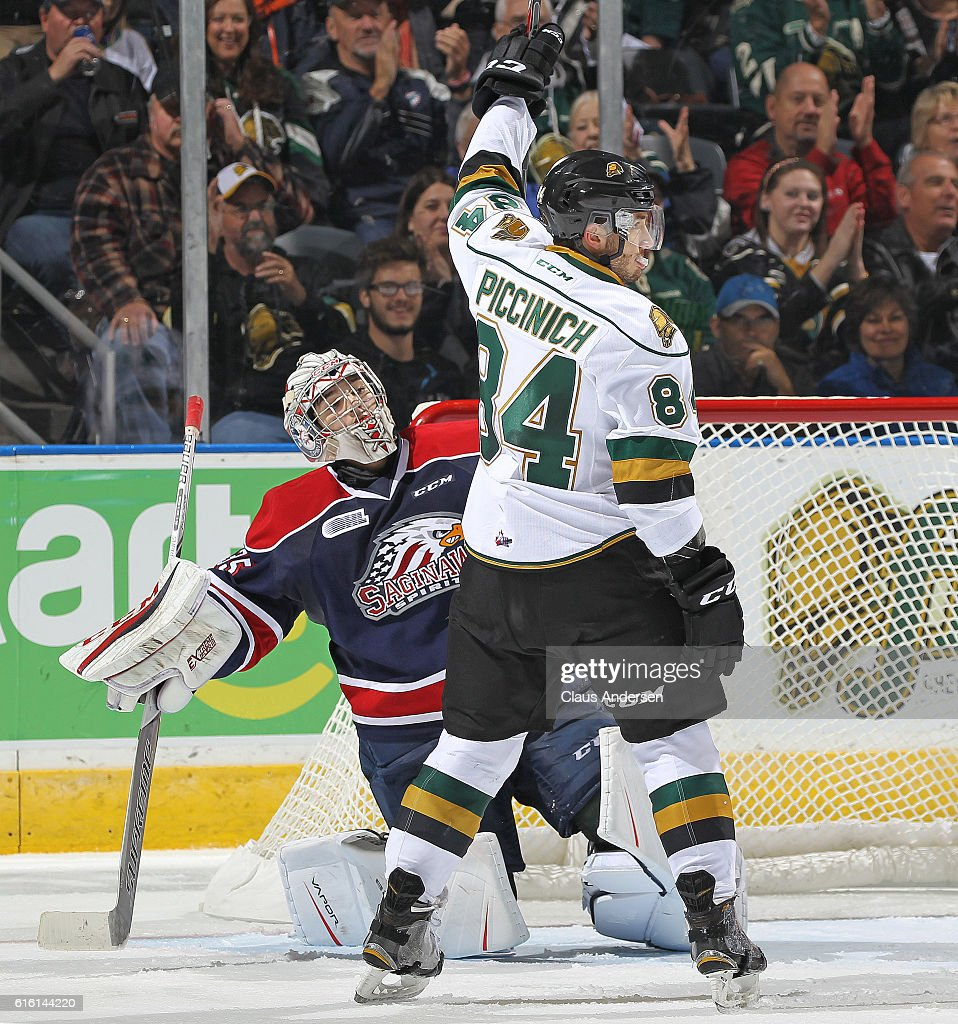 JJ Piccinich #84 of the London Knights celebrates a goal against Evan Cormier #35 of the Saginaw Spirit during an OHL game at Budweiser Gardens on October 21, 2016 in London, Ontario, Canada. The Knights defeated the Spirit 5-1.