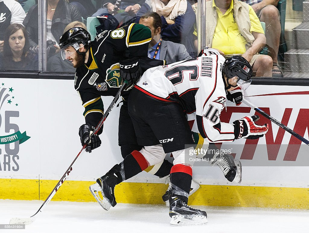 JJ Piccinich #84 of the London Knights (OHL) collides with Jean-Christophe Beaudin #16 of the Rouyn-Noranda Huskies (QMJHL) during the Memorial Cup Final on May 29, 2016 at the Enmax Centrium in Red Deer, Alberta, Canada.