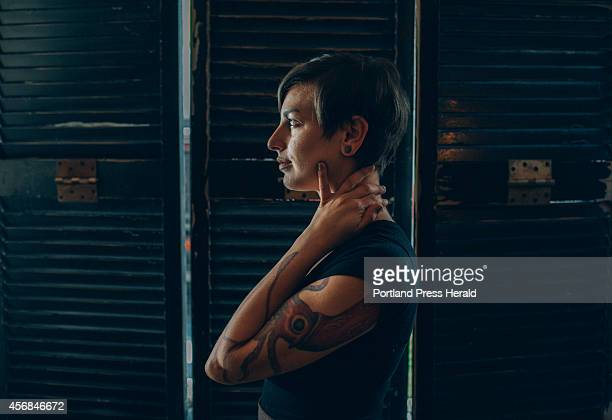 Piccolo restaurant server Kelly Nelson has a squid tattoo on her bicep and shoulder which extends down to her wrist in Portland ME Thursday October 2...