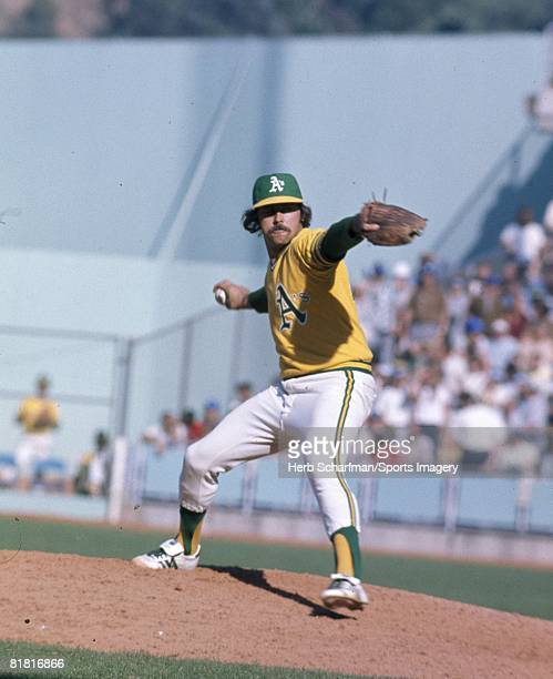 Picher Jim 'Catfish' Hunter of the Oakland Athletics pitches to the Los Angeles Dodgers during the 1974 World Series at the OaklandAlameda County...