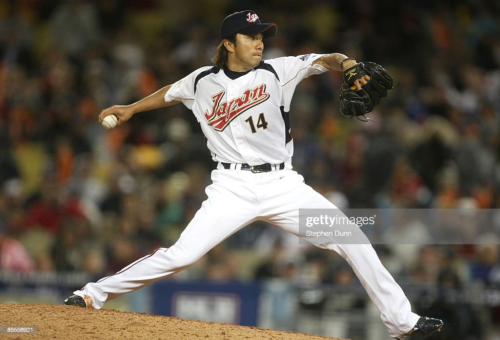 Picher Takahiro Mahara #14 of Japan delivers a pitch against the United States in the semifinal game of the 2009 World Baseball Classic on March 22, 2009 at Dodger Stadium in Los Angeles, California.
