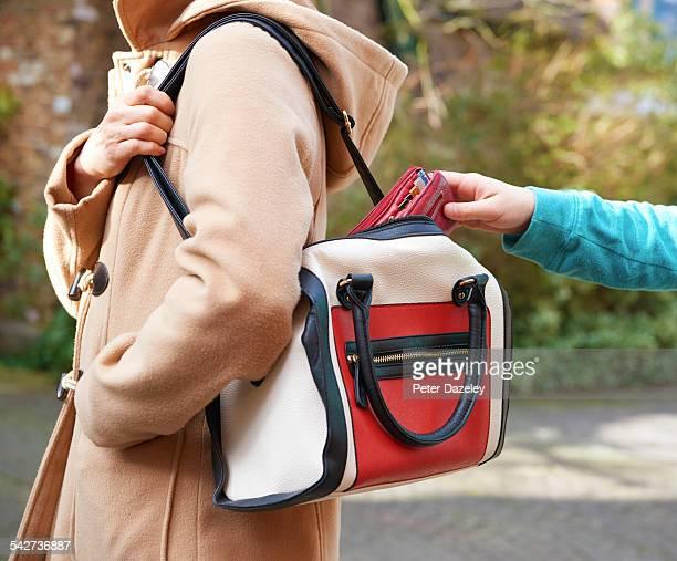 Pick pocket taking wallet