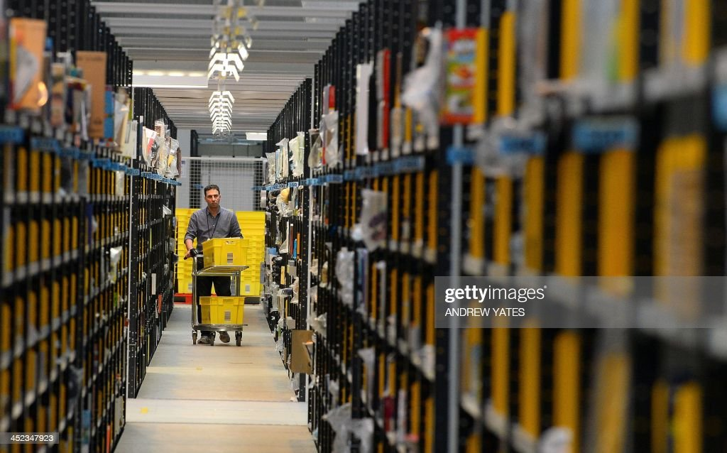 A 'picker' collects order items at the Fulfilment Centre for online retail giant Amazon in Peterborough, central England, on November 28, 2013, ahead of Cyper Monday on December 2nd, expected to be one of the busiest online shopping days of the year.