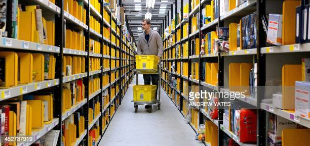 A 'picker' gathers stock at Amazon's Fulfilment Centre in Peterborough central England on November 28 2013 'Cyber Monday' which falls this year on...
