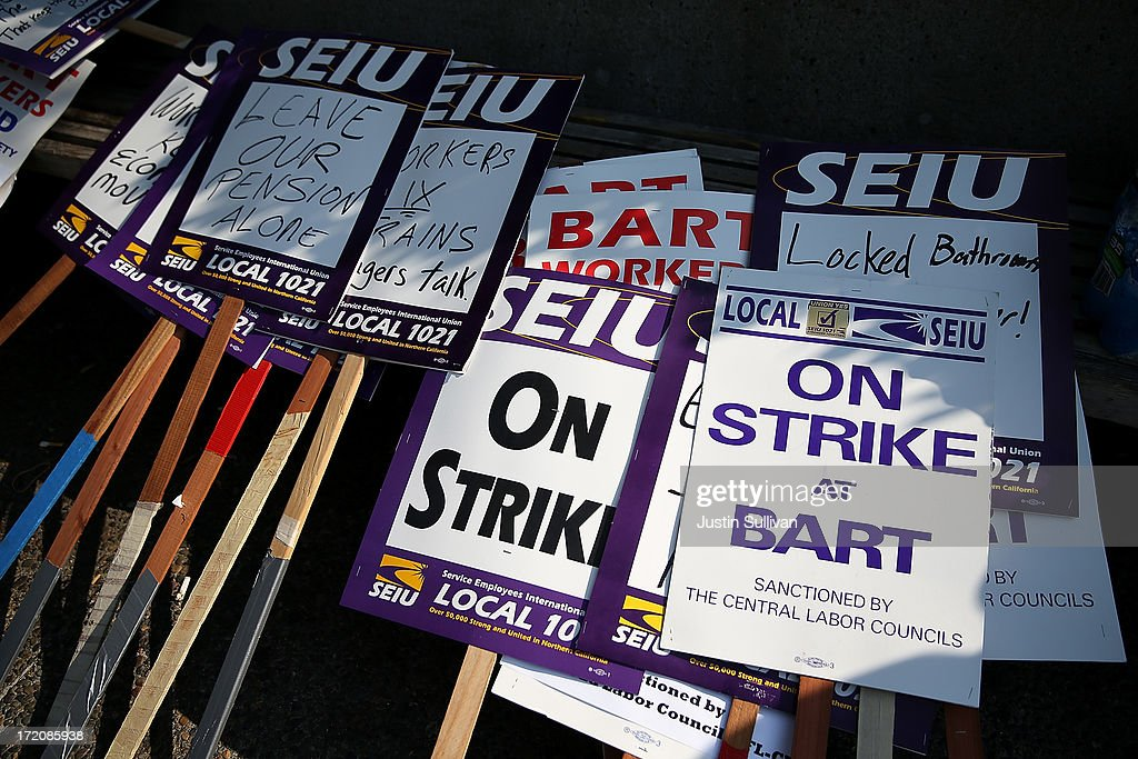 Picket signs sit in a stack outside of the Bay Area Rapid Transit (BART) Lake Merritt station on July 1, 2013 in Oakland, California. Hundreds of thousands of San Francisco Bay Area commuters are scrambling to find ways to work after the Bay Area Rapid Transit (BART) workers from the Amalgamated Transit Union Local 1555 went on strike at midnight after contract negotiations with management fell apart on Sunday. Train operators, mechanics, station agents and maintenance workers are seeking a five percent wage increase and are fighting management who want to have workers to begin contributing to their pensions, pay more for health insurance and reduce overtime expenses.