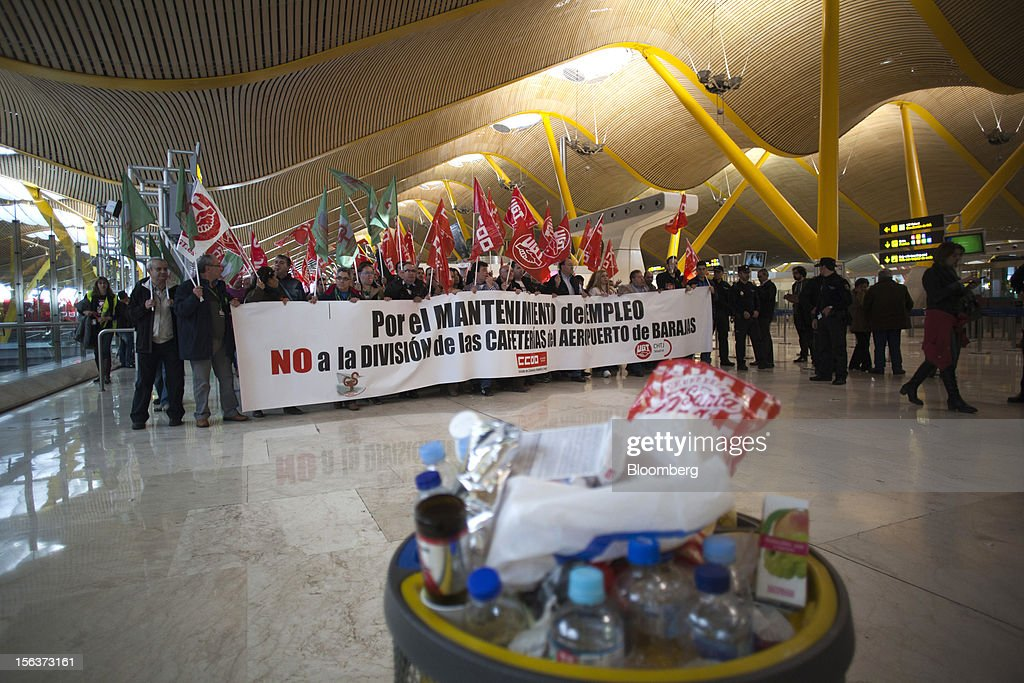 Pickets call for strike action and protest against government austerity measures inside the terminal at Madrid airport on the morning of a general strike in Madrid, Spain, on Wednesday, Nov. 14, 2012. Spanish unions today staged their second general strike against Prime Minister Mariano Rajoy as mounting opposition to budget cuts and bank bailouts undermines the 11-month-old government's ability to repair the economy. Photographer: Angel Navarrete/Bloomberg via Getty Images