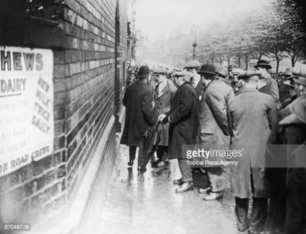 Pickets intercept an L M S Railway clerk attempting to go to work in Crewe during the General Strike10th May 1926