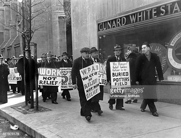 WPA pickets marching along Fifth Avenue on Easter Sunday protesting Work Progress Administration policies New York New York April 9 1939