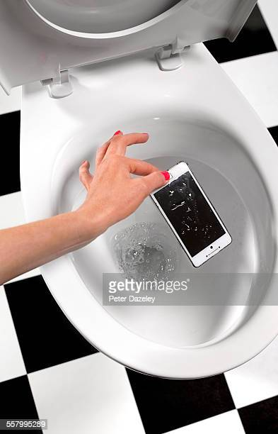 Picking smart phone out of toilet