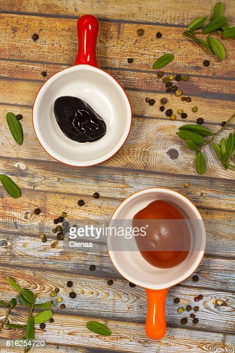 Pickled plums and tomatoes. Green leaves. Still life : Foto de stock