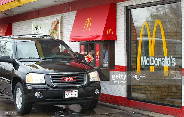 SUV picks up an order at the driveup window of a McDonald's fast food restaurant April 30 2003 in Niles Illinois McDonald's Corporation announced...