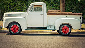 A white pickup sitting on a southern California street.
