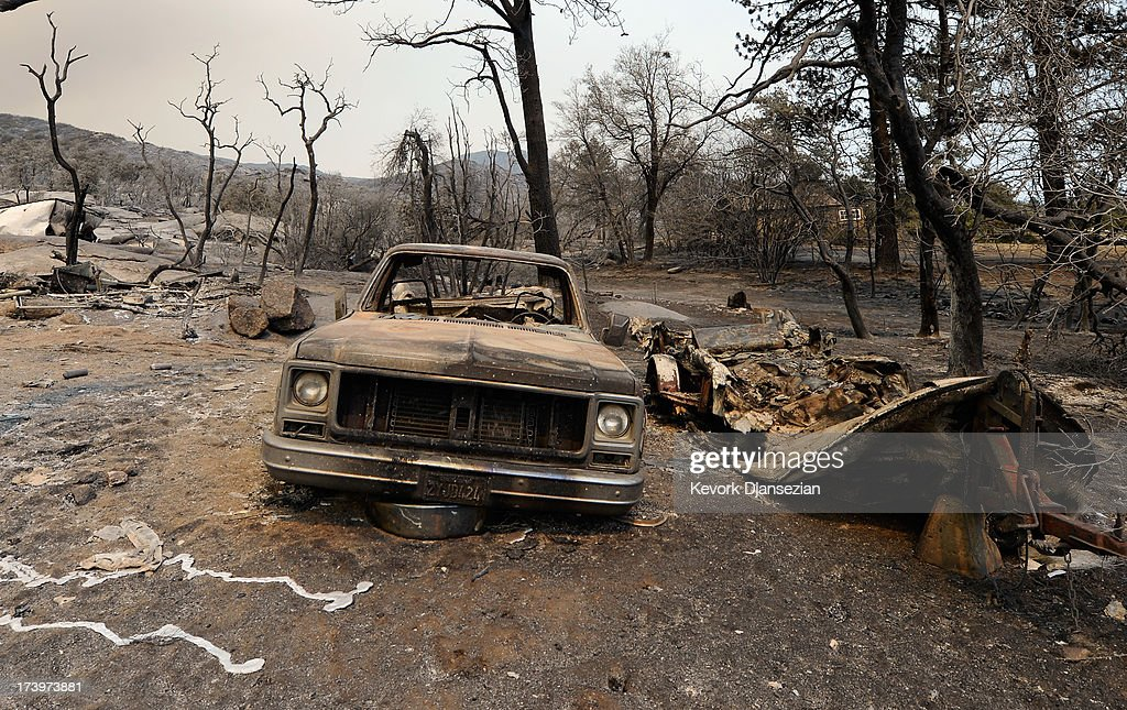 A pickup is shown in the wake of the Mountian Fire after it scorched the area on July 18, 2013 near Idyllwild, California. The massive wildfire in Riverside county has grown to 23,000 acres and is advancing towards the mountain town of Idyllwild on one front and city of Palm Springs on the other front destroying several homs and forcing the evacuation of 6,000 people.