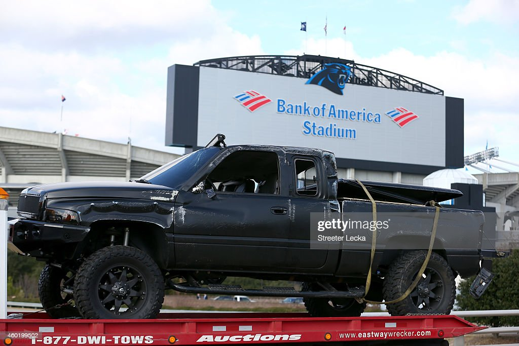 A pickup truck belonging to quarterback <a gi-track='captionPersonalityLinkClicked' href=/galleries/search?phrase=Cam+Newton+-+American+Football+Quarterback&family=editorial&specificpeople=4516761 ng-click='$event.stopPropagation()'>Cam Newton</a> of the Carolina Panthers, that was involved in a roll over accident, is towed away from in front of Bank of America Stadium on December 9, 2014 in Charlotte, North Carolina. Newton was transported from the scene in an ambulance after he was invovled in a car accident.
