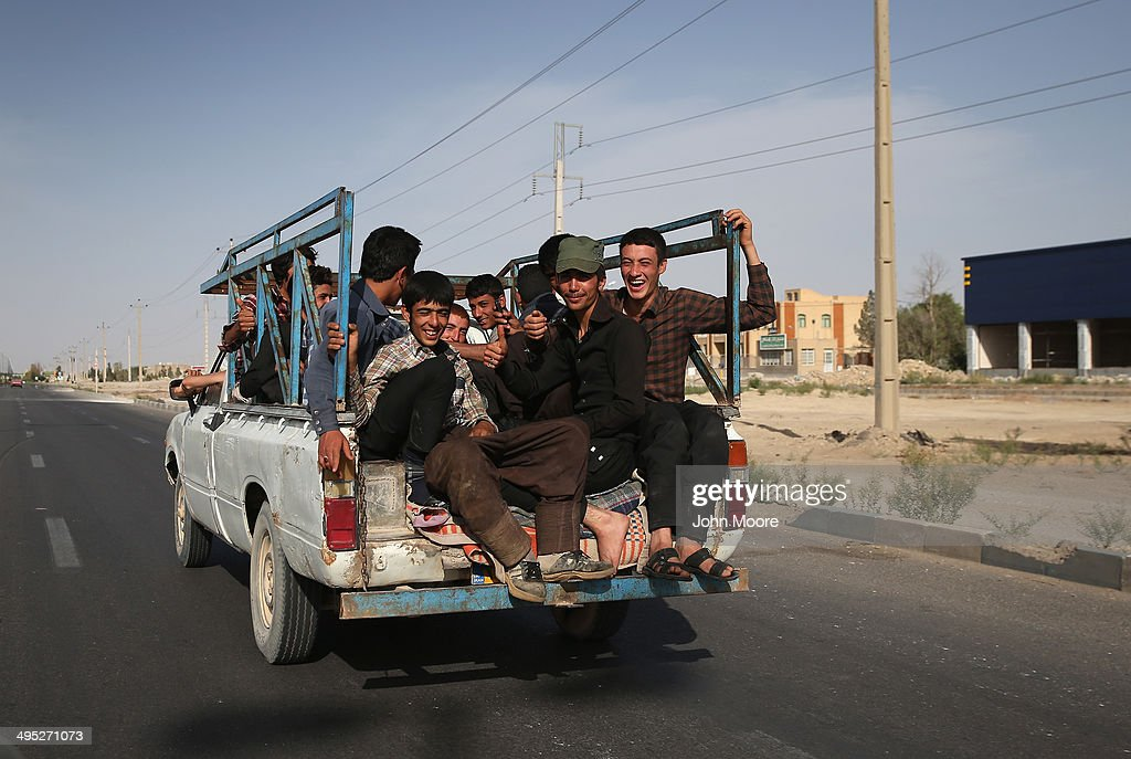 A pickup truck full of young men rides through town on May 30, 2014 near the town of Abarqu, in central Iran. This week marks the 25th anniversary of the death and continued legacy of the Ayatollah Khomeini, the father of Iran's Islamic Revolution, only the latest chapter of Persia's long history.