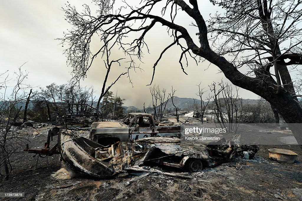 A pickup truck is shown in the wake of the Mountian Fire after it scorched the area on July 18, 2013 near Idyllwild, California. The massive wildfire in Riverside county has grown to 23,000 acres and is advancing towards the mountain town of Idyllwild on one front and city of Palm Springs on the other front destroying several homs and forcing the evacuation of 6,000 people.