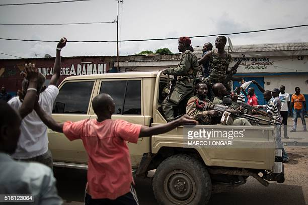A pickup truck loaded with a Congolese rebel group headed by Reverend Frederic Bitsangou alias Pastor Ntumi escorts a convoy speeding through the...