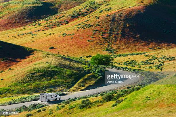 Pickup truck on winding road through country hills