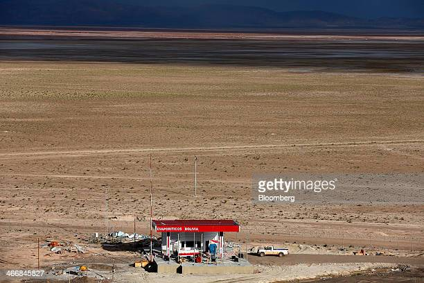 A pickup truck sits outside one the buildings at the state mining company Comibol's lithium production complex in Llipe Bolivia on the edge of the...