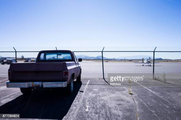 Pickup truck stop at the parking lot in front of the airport.