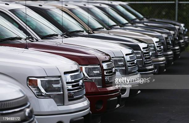 F150 pickups are seen on the sales lot at a Ford AutoNation car dealership on September 4 2013 in North Miami Florida Ford announced it sold 221270...