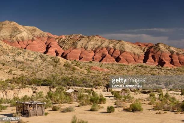 Picnic area at red and white eroded Aktau mountains in Altyn Emel National Park Kazakhstan