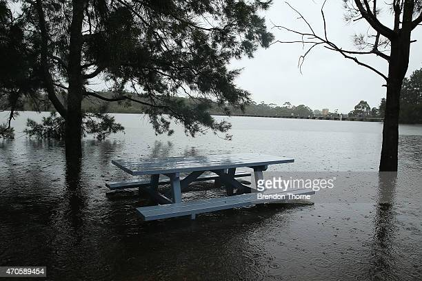 A picnic area is flooded at Manly Dam as water spills over the dam on April 22 2015 in Sydney Australia Three people have died and more than 200000...