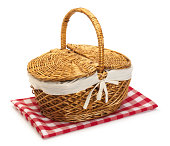 Picnic basket and classic picnic tablecloth on white surface with soft shadow.To see other picnic baskets click: