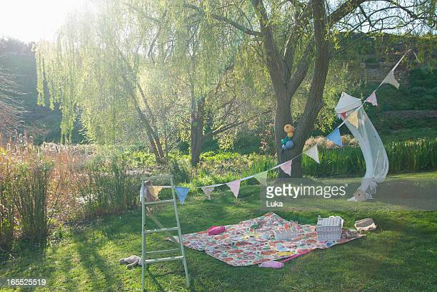 Picnic blanket and bunting outdoors