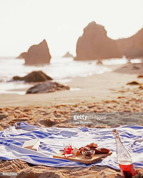 Picnic blanket on sandy beach