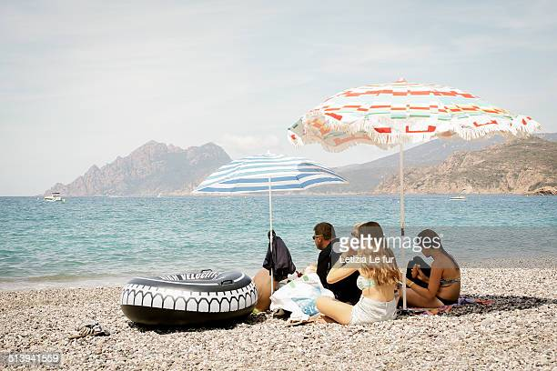 Picnic in family on Porto's beach Corsica France