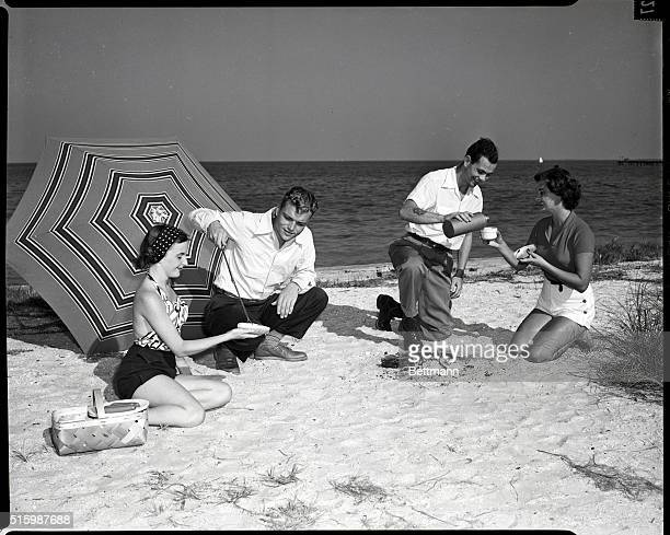 Picnic on the beach Models Sara Burniss Geraldine Rooney Edward A Stevens Jr and William Von Wenlar