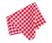 Checkered gigham folded red picnic cloth isolated.