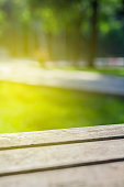 Closeup photograph of picnic table and wood texture with shallow depth of field.