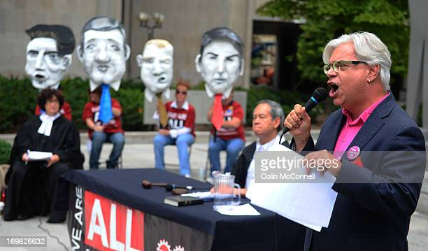 Pics of Fred Hahnpresident cupe testifies against the four mock ups Mock trial on austerity held outside University courthouse featuring giant...