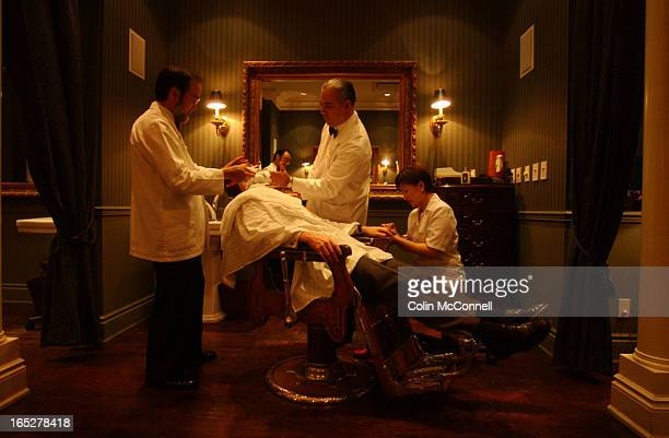 11/25/03 pics of owner in middle ricky ricci foaming up michael mountford while barber don lee shaves him and esthitician ruth zang gives him a...