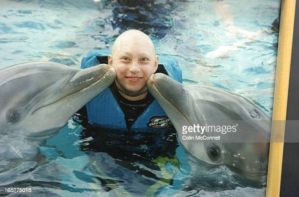 10/10/06 pics of ulana kopystansky whose 13yr old daughter taissa died of cancer but was helped by the make a wish foundation to swim with the...
