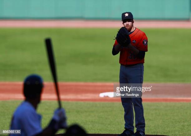 Picther Collin McHugh of the Houston Astros looks for a call in the bottom of the second inning during the game against the Boston Red Sox at Fenway...