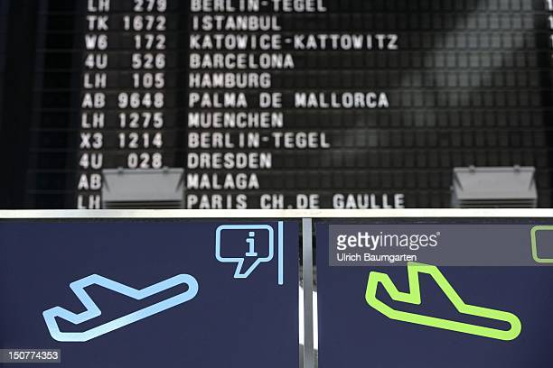 GERMANY BONN Pictograms for takeoffs and arrival in front of the scoreboard for the takeoffs at the airport