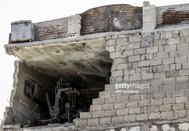 A pictrure shows a damaged factory in Aleppo's Kallase industrial neighbourhood on July 5 2017 Six months after Syria's army captured the country's...