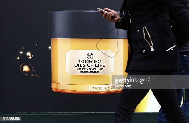 A picture advertising sleeping cream sits on a hoarding outside a Body Shop International Plc store owned by L'Oreal SA in London UK on Thursday...