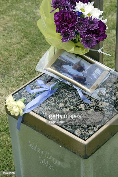A picture and flowers adorn the chair of Ashley Megan Eckles a victim of the Oklahoma City Murrah Federal Building bombing following the Eighth...