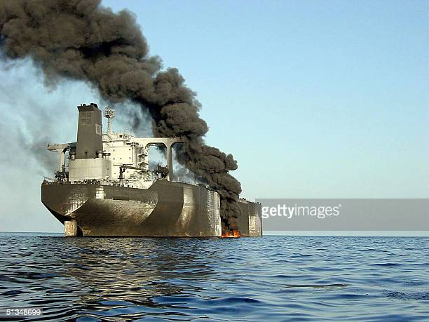 A picture dated 06 October 2002 shows a cloud of smoke billowing from French supertanker Limburg off the coast of the southeastern Yemeni port of...