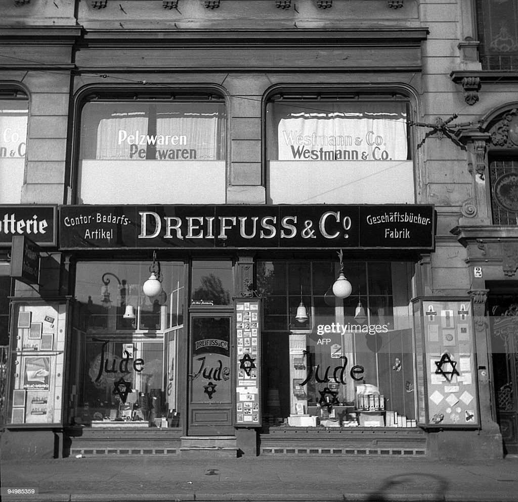 A picture dated 10 November 1938 in Germany showing a Jewishrun shop after being vandalized by Nazis and inscripted with antisemitic graffitis...