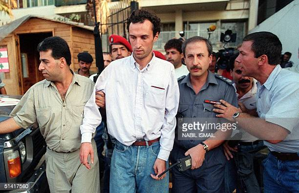 Picture dated 11 August 1991 shows members of Lebanese security forces escorting the French hostage Jerome Leyraud after his release in Beirut