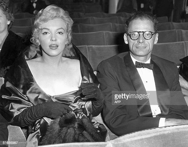 Picture dated 11 October 1956 showing actress Marilyn Monroe and her husband writer Arthur Miller at the Comedy Theatre in London as they are waiting...