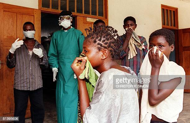 A picture dated 14 May 1995 shows relatives of patients affected by the deadly Ebola virus waiting for news outside the Kikwit hospital 530 km...